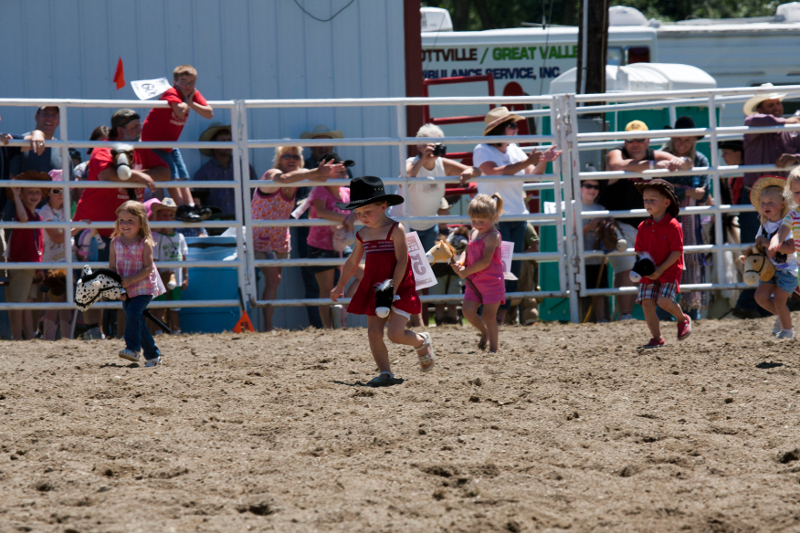 Little Kids in a stick horse race at the Ellicottville Championship Rodeo