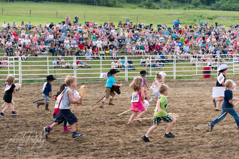 Kids in a stick horse race at the Ellicottville Rodeo!